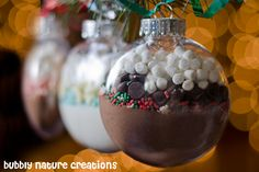 CHRISTMAS:  Hot Cocoa Mix Ornament -Good Secret Santa gift. There is nothing like hot cocoa on a chilly winter day. Pour hot cocoa mix, sprinkles, chocolate chips, and mini marshmallows into a clear glass ornament. You might also tie a b right bow and a card to the hanger listing ideas for refiling the ornament as a tree decoration. ~ Advent/Christmas Season