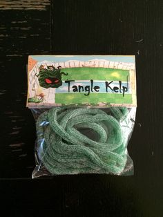 I put together Tangle Kelp candy bags for my son's 8th birthday party. The candy is sour apple strings. I created the tag art myself. Plants vs Zombies