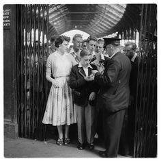 Ticket inspector, Victoria Station, London c.1960 by Bob Collins. www.TheTripStudio.com