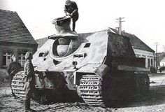 This captured Sturmtiger is getting quite a bit of attention from some Russians due to it's rarity in Panzer divisions and large Naval type gun.