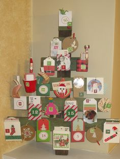 Christine and Mike's Advent Calendar (The Christmas Tree base bought at a craft fair.)