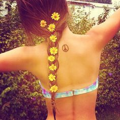 flowers. peace tattoo. tye dye suit