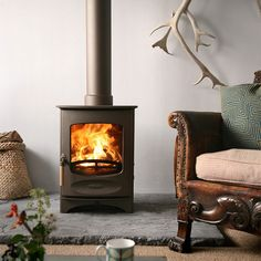 A wood burning stove has a flat bottom on which the wood burns on a bed of wood ash. Wood burns more slowly in a woodburning stove. Fireplace Stores, Stove Fireplace, Fireplace Design, Cottage Fireplace, Granite Hearth, Slate Hearth, Wood Stove Hearth Pads, Charnwood C4, Rm 1