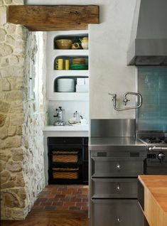 this French country kitchen from a home in Monte Sereno, California strikes the perfect balance between rustic and elegant. I love all the natural elements here, the open shelving and nooks, and the big island, not to mention the windows and fab aqua backsplash