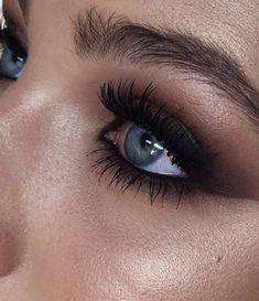 black smokey eye + bronzed shimmer glowy skin | blue eyes makeup ideas