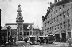 The Denver Horse Railroad Company, which started operations in 1871, was the city's first transit company. That's the stable, now the Sheridan Building at 17th and Wynkoop Streets, and the original Union Station. Photo courtesy of the Denver Public Library Western History Department.
