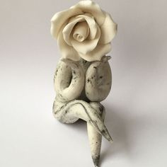 Ceramic flower sculptures by Cazamic - Carolyn Clayton is a ceramic sculpture artist making ceramic flower people sculptures.