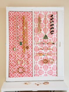 For a jewelry board.. 1. Using an X-Acto knife, cut balsa wood to fit the dimensions of the window panes. 2. Attach batting to one side of the balsa with spray-on glue. Place fabric over the batting and pull it taut, then staple it to the backside of the balsa. 3. Use an awl or drill to make holes in the back of the balsa, then screw hooks (just do it by hand) through the front of it. 4 Attach the finished boards to the windows with a glue gun.