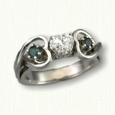 14kt White Gold Celtic Twin Hearts Engagement Ring set with a heart shaped diamond and side alexandrites  All stones available in any metal