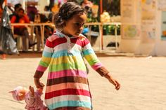 Little girl in the plaza.