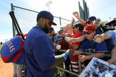 Prince Fielder signs autographs for a mob of adoring Rangers fans.