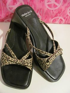 CHARLES & DAVID    WOMENS LEOPARD PRINT    SLIDE SANDALS    SIZE 9    2 IN HEEL    MINT CONDITION FOR    PREOWNED    CUTE BOW    SEE PICS    GREAT WITH SHORTS, JEANS    OR A CUTE SUNDRESS    MADE IN ITALY    WONDERFUL ADDITION TO    YOUR WARDROBE