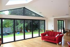 like the triangle window and black frames but want the bottom windows/doors to be smaller panes Extension Veranda, House Extension Design, Extension Designs, Roof Extension, House Design, Extension Ideas, Glass Extension, Bungalow Extensions, House Extensions