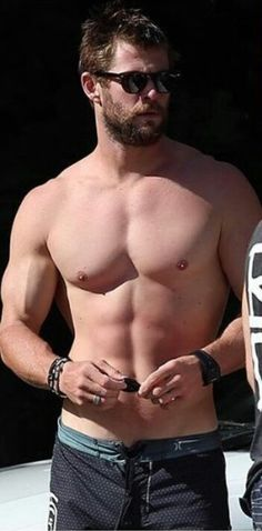 Chris Hemsworth - - - It's amazing that he can just stand around and look like that!