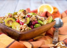 Roasted Brussels sprouts with cranberries and walnuts are a perfect addition to your Thanksgiving or Christmas table. They are simple, festive, and delicious! Potluck Recipes, Veggie Recipes, Salad Recipes, Dinner Recipes, Healthy Recipes, Delicious Recipes, Veggie Side Dishes, Vegetable Sides, Deli Salad Recipe