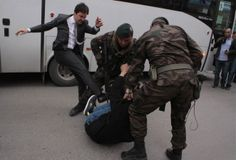 MEHMET EMIN AL, A protester is kicked by Yusuf Yerkel, advisor to Turkey's Prime Minister Tayyip Erdogan, a specail forces police officers detain him during a protest against Erdogan's visit to Soma on May 14, 2014
