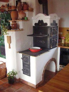 This beautiful masonry stove and heater is from friend Nemeth Janos. Notice the central chimney, which means that this is in middle of the house and other wood stoves from other rooms in the house are piped into a central chimney. www.cordwoodconstruction.org