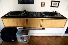 Check out this awesome Floating DJ Table and other cool DJ setup and booth. Vinyl Storage, Record Storage, Stockage Record, Dj Table, Tables, Whole Home Audio, Dj Stand, Dj Decks, Music Studio Room