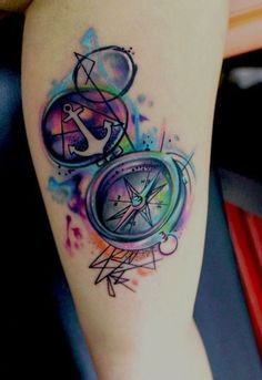 Compass and anchor tattoo in watercolour on leg for girl