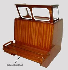 In Stock     Boston Whaler 16'/17' Nauset, Sakonnet or Easport mahogany console complete with windshield.  Available with or without the optional front seat, and also the front seat with cushions (use dropdown menu above), you can also view these cushions installed in photo above. This console was standard on many 16'/17' classic Boston Whalers from the 60's and 70's.     This console can also be used in newer Montauk and Outrage hulls, or any boat that is configured for a center console…