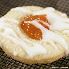 KOLACHKE (Martha Stewart's) 1/4 cup sour cream, room temperature 1 (2 1/4 t) pkg active dry yeast 1 large egg, lightly beaten 1 cup (2 sticks) unsalted butter, cut into small pieces 2 cups all-purpose flour, plus more for dusting 1 cup fruit preserves; 400*, 12 min.