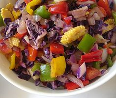 Salad with ginger-honey dressing recipe   Chop one each of red, yellow, green peppers, onion, red apple, 2-3 baby corns, 1/2 cup cabbage and few green seedless grapes. Whisk together 1″ grated ginger, 2 crushed garlic cloves, 1 tbsp lemon juice or vinegar, 1 tbsp olive oil, 1 tbsp honey, 1/2 tsp soya sauce and pepper to taste. Combine this dressing with the chopped vegetables and fruits. Chill and serve.