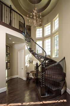 Spiral staircase # large window #light on dark wood