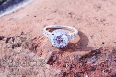 #Sanders Jewelers | #Gainesville, FL | This 3ct center stone with diamond halo ring is really an eye catcher!