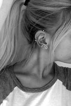 multiple earrings // industrial piercing -- I would just want simple studs♡