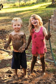 Playing in the dirt... seems like fun. Don't believe it? Just see those little faces and you tell me if they are suffering... haha!