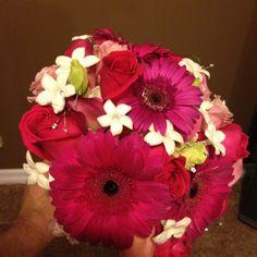 Keiko roses, deep pink gerbera, pink lisianthus, hydrangea and stephanotis.  Light rhinestones and a bling wrap.