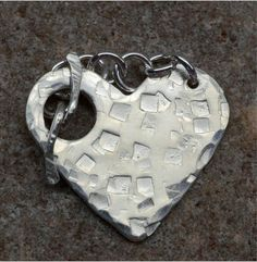 Originally $20 This heart shaped clasp is made of 20 gauge sterling silver, then I hammered a pattern on it. The bar is made from sterling silver wire.
