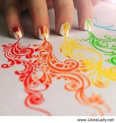 Awesome nail art. I probably would make the pencils smaller and try to include the designs on the paper into the nail.