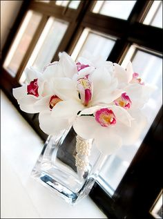 White cymbidium orchids with pearl-wrapped stems - Photo by Kara