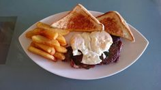 Steak & eggsa with steak cut french fries and manchego grilled cheese