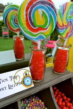 Giant lollipops at an Alice in Wonderland birthday party!  See more party ideas at CatchMyParty.com!