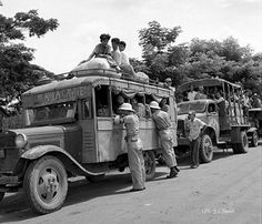 Manila to Cavite bus being checked by Military Police, Sept. 1945   by J. Tewell