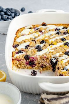Beautiful lemon blueberry baked oatmeal made with fresh lemon juice & zest and naturally sweetened with pure maple syrup. This lemon baked oatmeal is gluten free & dairy free with bursts of fresh blueberries and poppy seeds in every bite. Drizzle with a homemade lemon yogurt topping for the perfect breakfast treat! #oatmeal #bakedoatmeal #blueberries #healthybreakfast #easter #brunch Baked Oatmeal Cups, Baked Oatmeal Recipes, 16 Bars, Biscuits, Lemon Poppyseed Muffins, Lemon Yogurt, Blueberry Oatmeal, Perfect Breakfast, Dairy Free