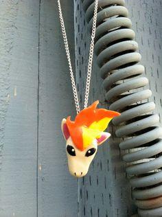 Pokemon Necklace- Ponyta Polymer Clay Charm. $15.00 USD, via Etsy.