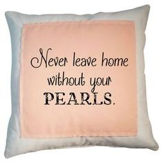 """Cotton pillow with a typographic motif and feather-down fill.     Product: PillowConstruction Material: Cotton cover and feather-down fillColor: White, pink and blackFeatures: Insert includedDimensions: 20"""" x 20""""Cleaning and Care: Dry clean only"""