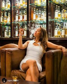 Most of us will agree that there is a particular allure of a woman smoking a cigar! Women smoking cigars might be a less common sight than men. Cigars And Women, Women Smoking Cigars, Smoking Ladies, Cigar Smoking, Girl Smoking, Smoking Room, Cigars And Whiskey, Good Cigars, Cuban Cigars