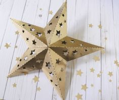 Paper Star Template: Paper Star Instructions and Free Template. If you're interested in a fun paper star lumieres tutorial and a free template, you've come to the right place! Keep reading! 3d Paper Star, Paper Stars, Paper Star Lanterns, Hanging Lanterns, Chinese Paper Lanterns, Paper Decorations, Baby Shower Decorations, Decoration Party, Papier Diy