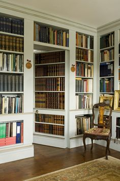 """Ideal for those dreaming of their own bookshop, these wall-lined bookcases are the quintessence of chic, adding the """"door"""" shelves really finishes it off in style—just make sure you have the books to complete the look!"""