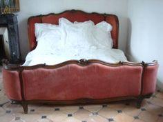 Yep, a red velvet french bed...