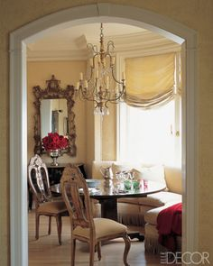 Upholstered walls in this dining room designed Alessandra Branca.