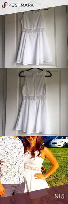 White summer dress This is a short white dress with a see thru lace middle. Only been worn once & in great condition H&M Dresses Mini