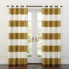 """Sophisticated modern curtain panels alternating horizontal stripes of ivory cotton and lustrous grey cotton sateen hang from oversized matte silver grommets. <a href=""""/rugs-and-curtains/curtain-hardware/1"""">Curtain hardware</a> also available.<br><br><NEWTAG/><ul><li>100% cotton face</li><li>Lining: 64% polyester 36% cotton</li><li>Matte silver grommets</li><li>3"""" hem</li><li>Dry clean only</li><li>Curtain panel lengths may vary slightly</li><li>Made in India</li></ul>"""