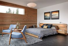 Seattle Floating Home by Dyna Contracting, Ninebark Design Build and Ryan Mankoski | Inside the house-on-water - a minimalist and earthy design to the main bedroom drawing in the colours of the surrounding waterscape and natural environment.