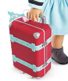 The new Girl of the Year loves to pack up and explore! Can you guess where she's going?
