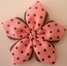 Ribbon flower tutorial, cute and easy!  Idea... Layer a smaller one on a larger one.